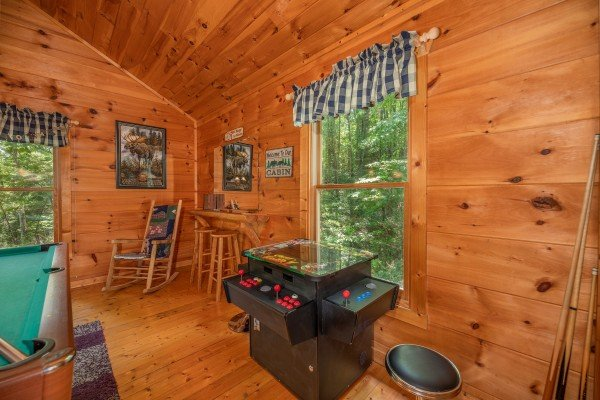 Arcade game in the game loft at Misty Mountain Escape, a 2 bedroom cabin rental located in Gatlinburg