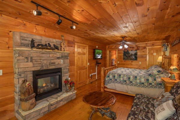Fireplace in the king bedroom at Misty Mountain Escape, a 2 bedroom cabin rental located in Gatlinburg