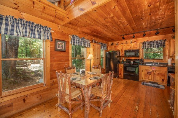 Dining room and kitchen at Misty Mountain Escape, a 2 bedroom cabin rental located in Gatlinburg