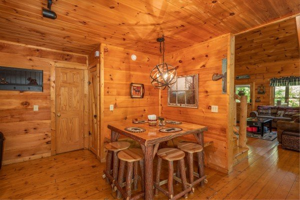 Dining space for eight at Misty Mountain Escape, a 2 bedroom cabin rental located in Gatlinburg