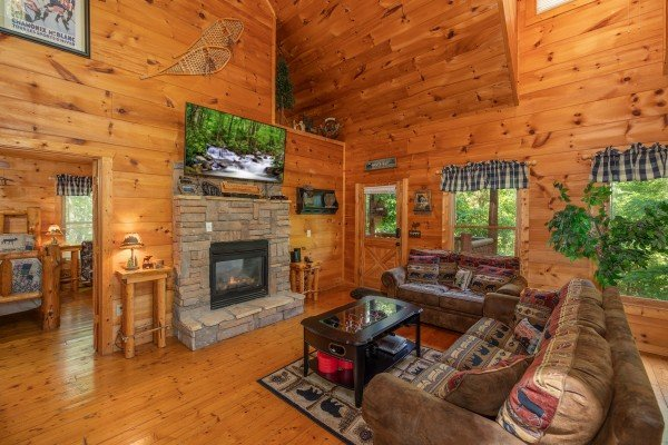 Fireplace and TV in the living room at Misty Mountain Escape, a 2 bedroom cabin rental located in Gatlinburg