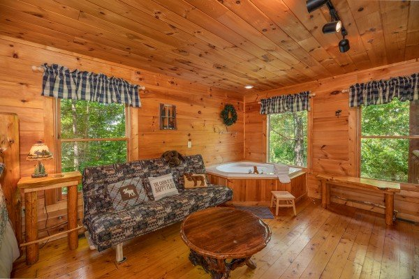 Futon and jacuzzi in the king bedroomat Misty Mountain Escape, a 2 bedroom cabin rental located in Gatlinburg