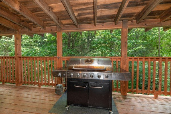 Grill on a covered deck at Misty Mountain Escape, a 2 bedroom cabin rental located in Gatlinburg