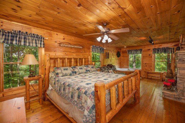 Bedroom with a king log bed at Misty Mountain Escape, a 2 bedroom cabin rental located in Gatlinburg