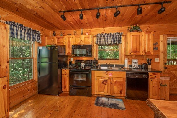 Kitchen with black appliances at Misty Mountain Escape, a 2 bedroom cabin rental located in Gatlinburg