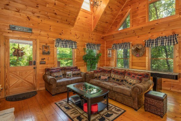 Sofa and loveseat in the living room at Misty Mountain Escape, a 2 bedroom cabin rental located in Gatlinburg