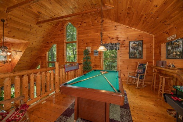 Green felt pool table at Misty Mountain Escape, a 2 bedroom cabin rental located in Gatlinburg