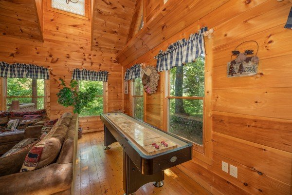 Shuffleboard game at Misty Mountain Escape, a 2 bedroom cabin rental located in Gatlinburg
