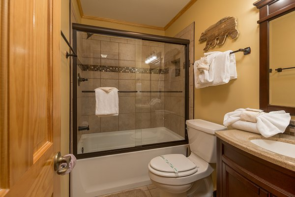 Bathroom with a tub and shower at Maple Top in the Smokies, a 3 bedroom cabin rental located in Pigeon Forge