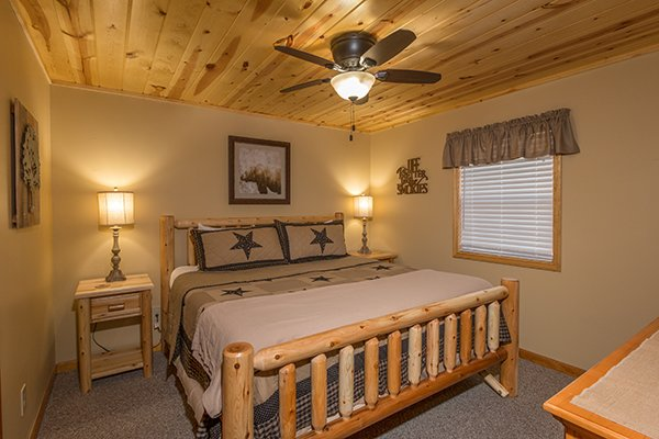 Bedroom with a king sized log bed at Maple Top in the Smokies, a 3 bedroom cabin rental located in Pigeon Forge