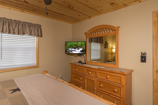 Dresser and TV in a bedroom at Maple Top in the Smokies, a 3 bedroom cabin rental located in Pigeon Forge