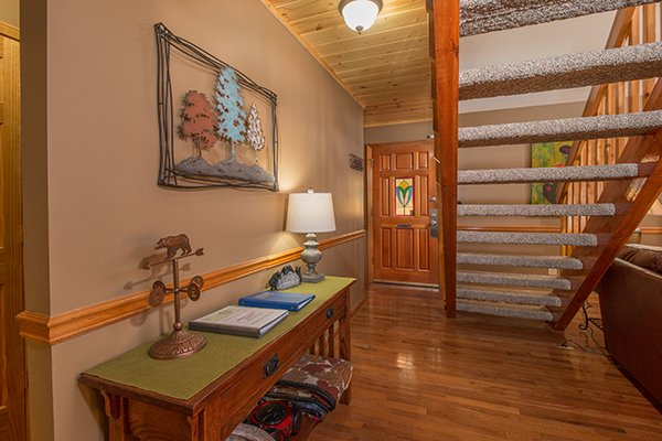 Foyer with long table at Maple Top in the Smokies, a 3 bedroom cabin rental located in Pigeon Forge