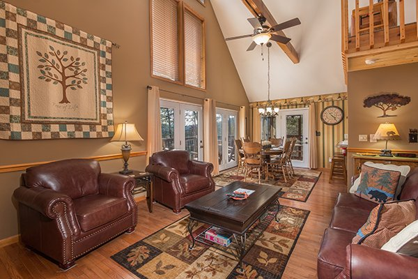 Living room with two chairs and a sofa at Maple Top in the Smokies, a 3 bedroom cabin rental located in Pigeon Forge