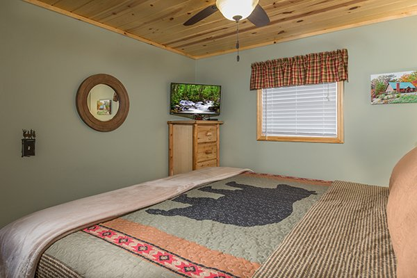 Bedroom with a dresser and TV at Maple Top in the Smokies, a 3 bedroom cabin rental located in Pigeon Forge