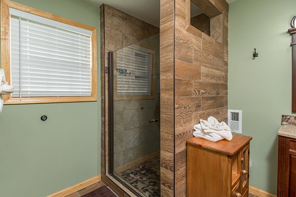 Custom glass shower at Maple Top in the Smokies, a 3 bedroom cabin rental located in Pigeon Forge