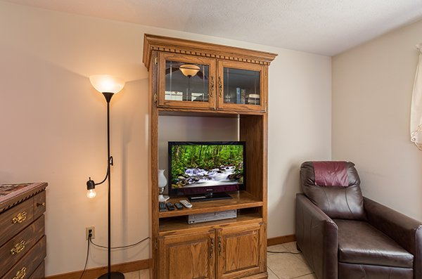 Bedroom television and storage space at Alone at the Top, a 3 bedroom cabin rental located in Pigeon Forge