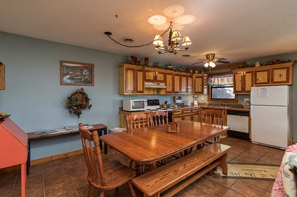 Dining room with four seats and a bench at Alone at the Top, a 3 bedroom cabin rental located in Pigeon Forge