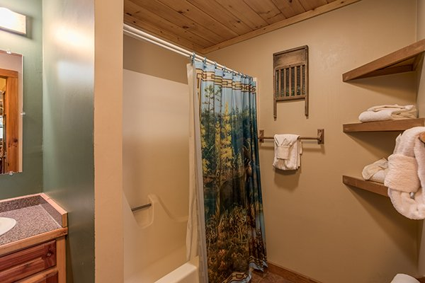 Bathroom with tub and shower at Alone at the Top, a 3 bedroom cabin rental located in Pigeon Forge