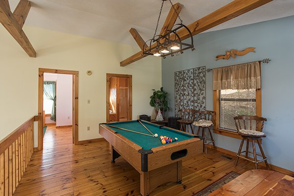 Pool table in the loft at Alone at the Top, a 3 bedroom cabin rental located in Pigeon Forge