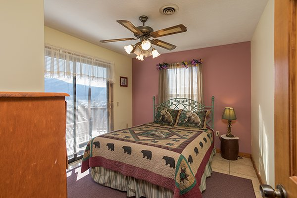 Queen bedroom with deck access at Alone at the Top, a 3 bedroom cabin rental located in Pigeon Forge