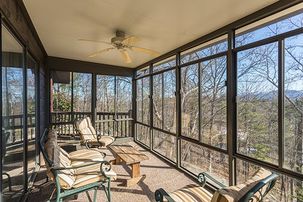 Sun porch with seating for four at Alone at the Top, a 3 bedroom cabin rental located in Pigeon Forge