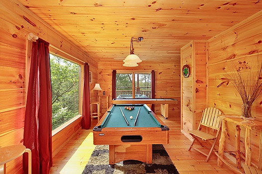 Game room pool table at Bearly Makin' it, a 1-bedroom cabin rental located in Gatlinburg
