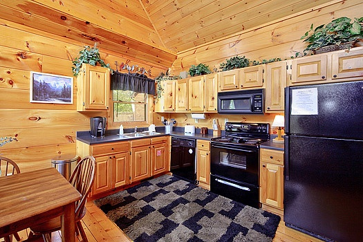 kitchen at bearly makin' it a 1 bedroom cabin rental located in gatlinburg