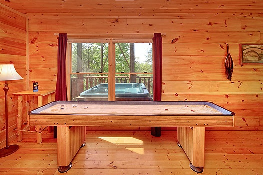 multi game table on top of pool table at bearly makin' it a 1 bedroom cabin rental located in gatlinburg