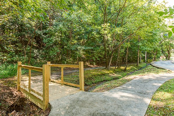 Walking trail at Alpine Mountain Village for guests of Hickory Hideaway, a 3-bedroom cabin rental located in Pigeon Forge