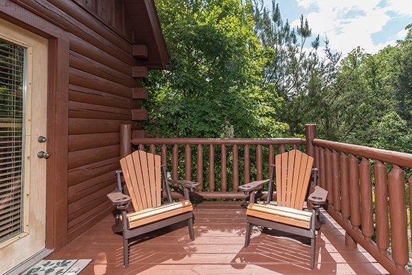 Adirondack chairs on the deck at Hickory Hideaway, a 3-bedroom cabin rental located in Pigeon Forge