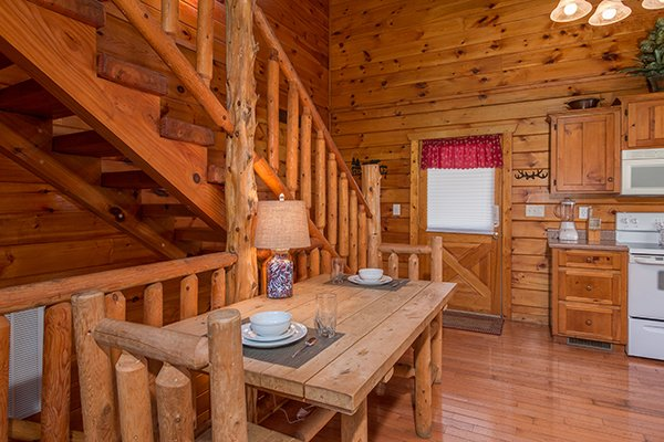 Small dining table for two in the kitchen at Hickory Hideaway, a 3-bedroom cabin rental located in Pigeon Forge