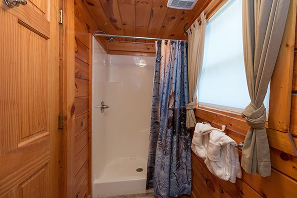 Bathroom on the first floor at Hickory Hideaway, a 3-bedroom cabin rental located in Pigeon Forge