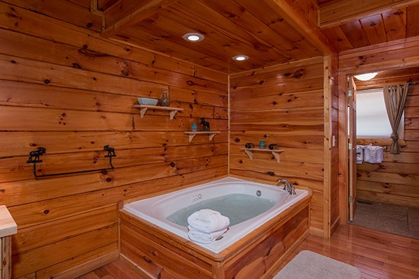 Jacuzzi tub in the main floor bedroom at Hickory Hideaway, a 3-bedroom cabin rental located in Pigeon Forge