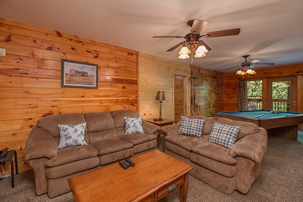 Sleeper sofa in the game room at Hickory Hideaway, a 3-bedroom cabin rental located in Pigeon Forge