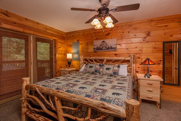 Bedroom with a king log bed at Hickory Hideaway, a 3-bedroom cabin rental located in Pigeon Forge