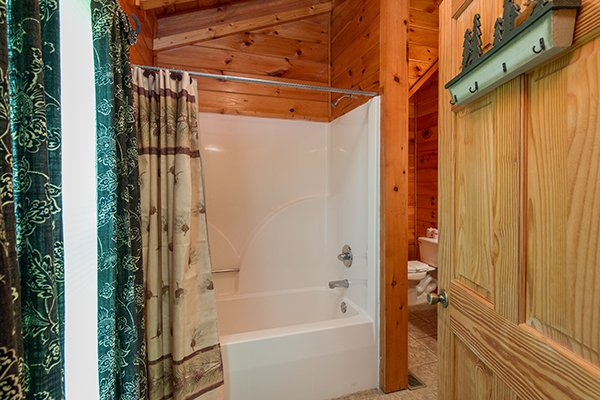 Bathroom with a tub and shower at Hickory Hideaway, a 3-bedroom cabin rental located in Pigeon Forge
