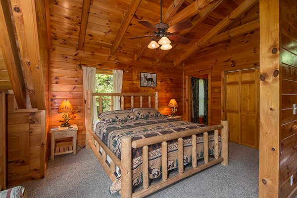 Loft bedroom with log bed at Hickory Hideaway, a 3-bedroom cabin rental located in Pigeon Forge