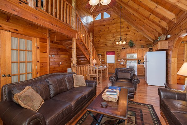 Living room and combination dining and kitchen at Hickory Hideaway, a 3-bedroom cabin rental located in Pigeon Forge