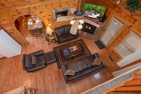 Living room from the second floor at Hickory Hideaway, a 3-bedroom cabin rental located in Pigeon Forge