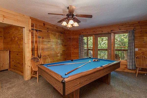 Pool table in the game room at Hickory Hideaway, a 3-bedroom cabin rental located in Pigeon Forge