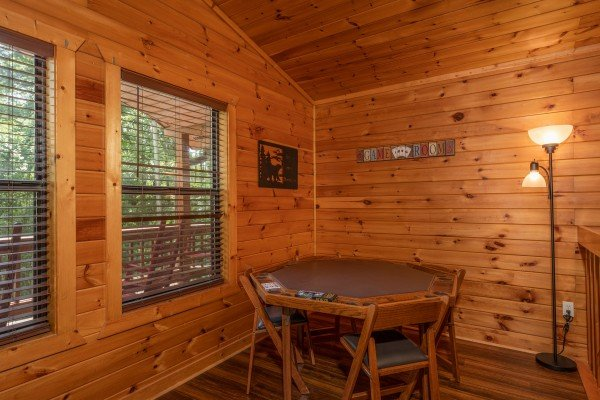 Card table at Hawk's Heart Lodge, a 3 bedroom cabin rental located in Pigeon Forge