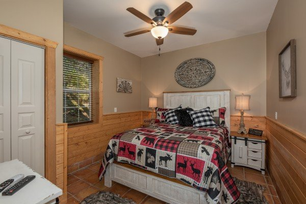 Bedroom with rustic furniture at Hawk's Heart Lodge, a 3 bedroom cabin rental located in Pigeon Forge