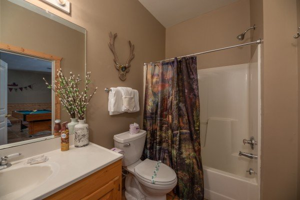 Bathroom with a tub and shower at Hawk's Heart Lodge, a 3 bedroom cabin rental located in Pigeon Forge