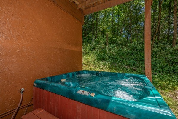 Hot tub at Hawk's Heart Lodge, a 3 bedroom cabin rental located in Pigeon Forge
