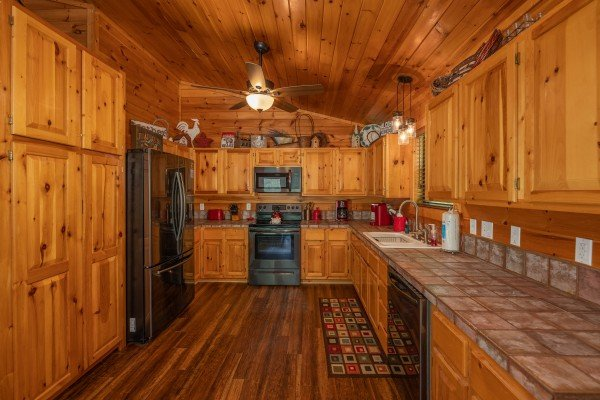 Kitchen at Hawk's Heart Lodge, a 3 bedroom cabin rental located in Pigeon Forge