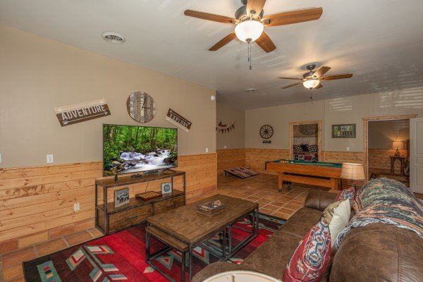 Living room with pool table at Hawk's Heart Lodge, a 3 bedroom cabin rental located in Pigeon Forge