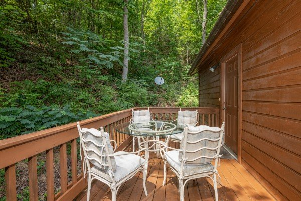 Outdoor dining set for four at Hawk's Heart Lodge, a 3 bedroom cabin rental located in Pigeon Forge