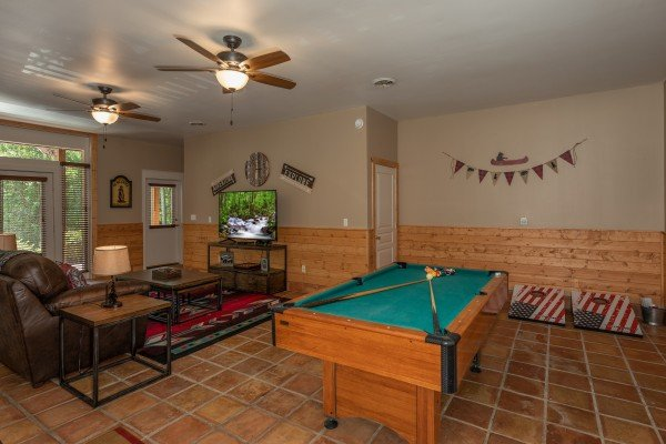 Pool table in the living room at Hawk's Heart Lodge, a 3 bedroom cabin rental located in Pigeon Forge