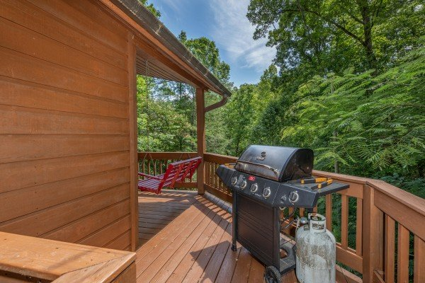 Propane grill on a deck at Hawk's Heart Lodge, a 3 bedroom cabin rental located in Pigeon Forge