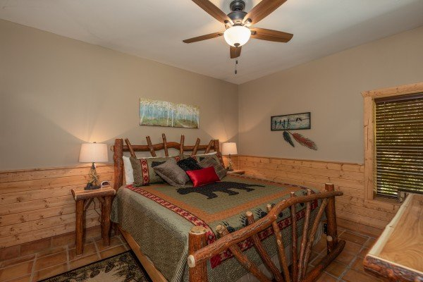 Bedroom with a log bed at Hawk's Heart Lodge, a 3 bedroom cabin rental located in Pigeon Forge